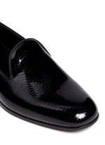 Chevron embossed patent leather slip-ons