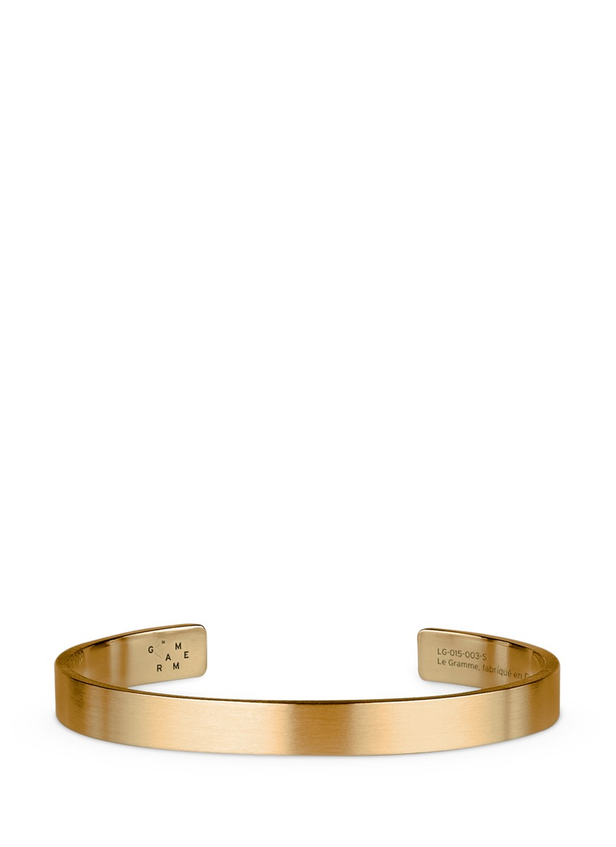 Le 21 Grammes brushed 18k yellow gold cuff by Le Gramme