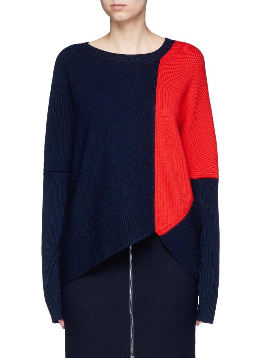 Asymmetric hem wool rib knit sweater by Comme Moi