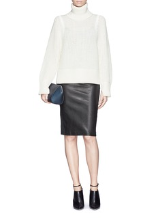 HELMUT LANG Split side wool knit turtleneck sweater