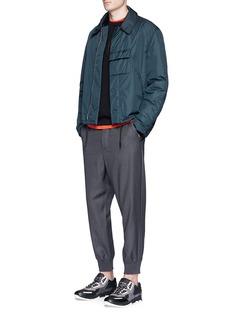 Christopher KaneLogo charm virgin wool pants