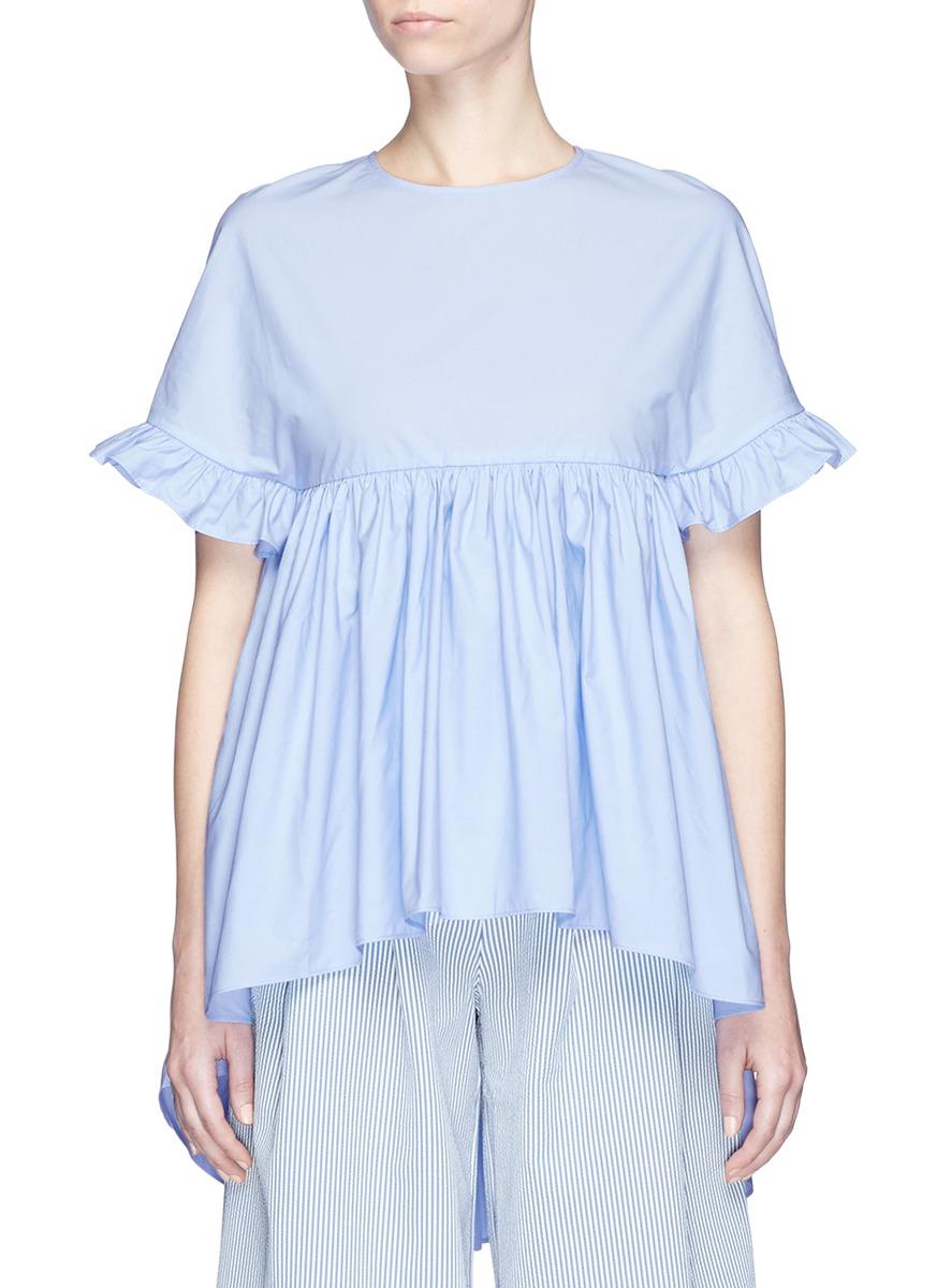 Ruffle trim dip hem cotton shirt by Xiao Li