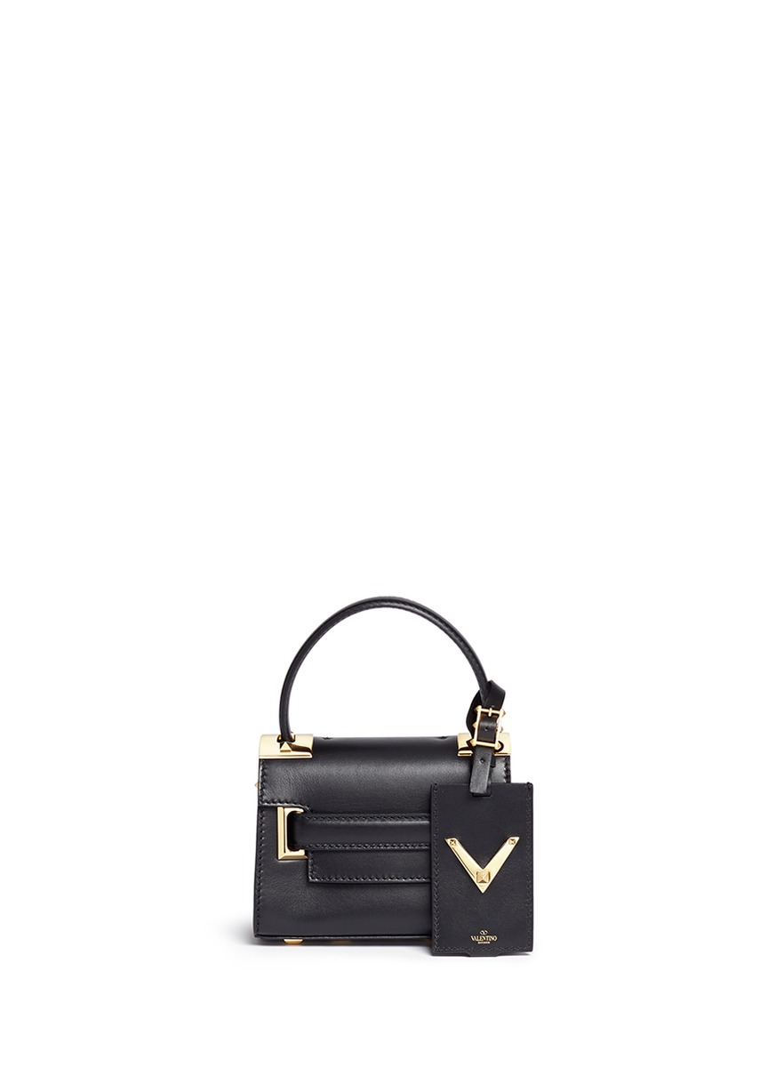 My Rockstud mini top handle leather bag by Valentino
