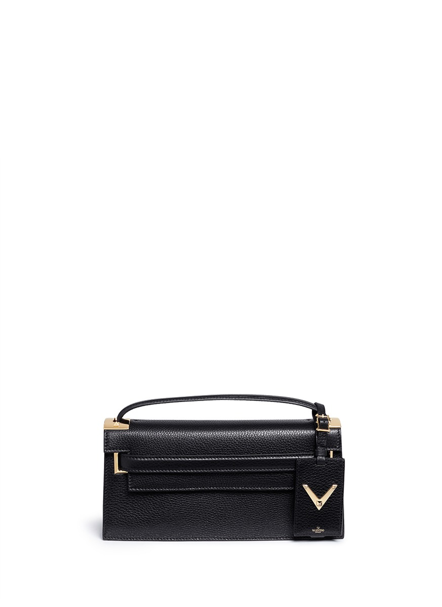 My Rockstud pebbled leather clutch by Valentino