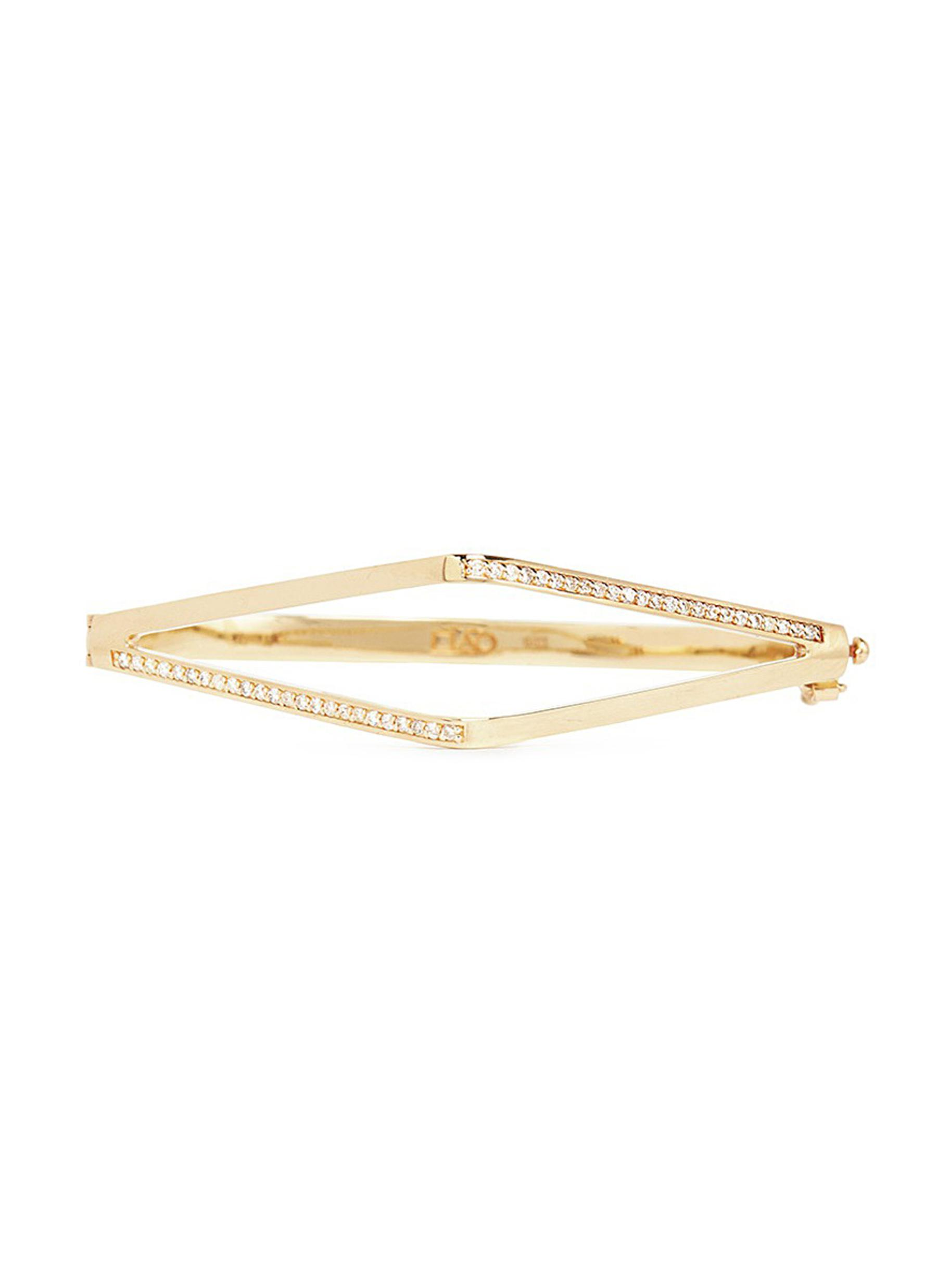 Diamond pavé 14k yellow gold cuff by Michelle Campbell