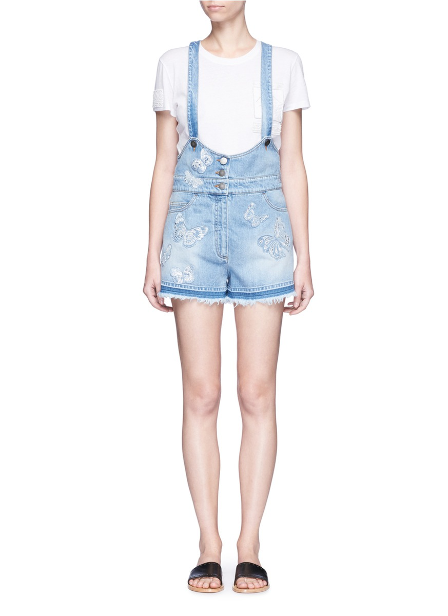 Butterfly embroidered appliqué denim overalls by Valentino