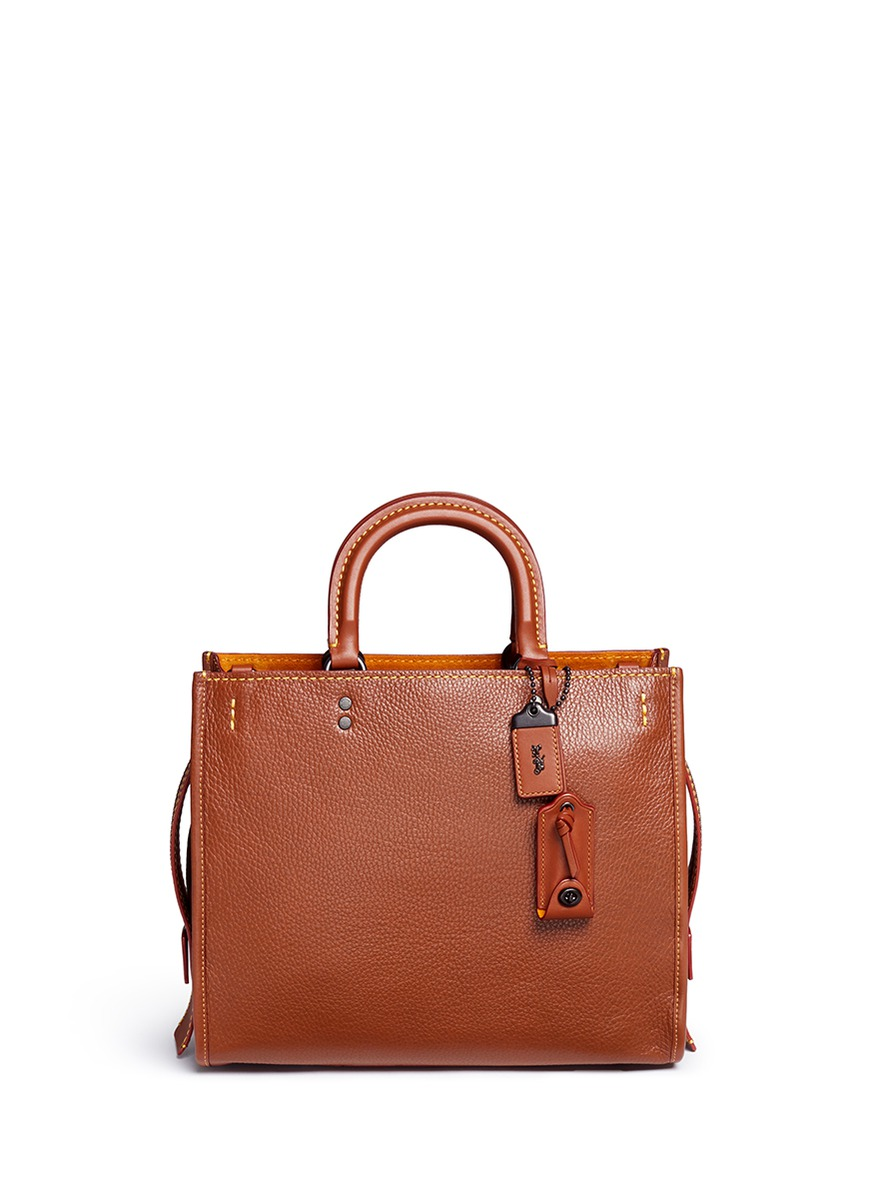 Rogue glovetanned leather bag by Coach