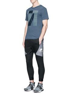 Nike'Nike International' logo print track pants