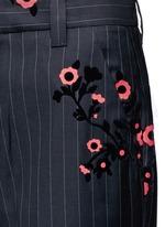 Floral flock velvet pinstripe pants