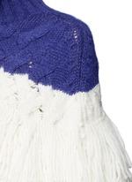 Layered loop fringe colourblock knit top