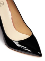 Arched collar patent leather pumps