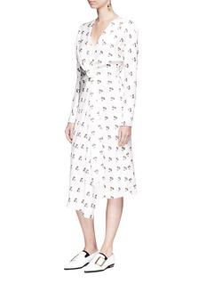 Victoria BeckhamDaisy print drape mock wrap dress