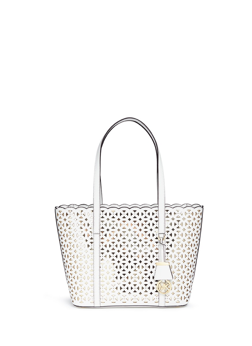 michael kors female desi small floral perforated leather travel tote