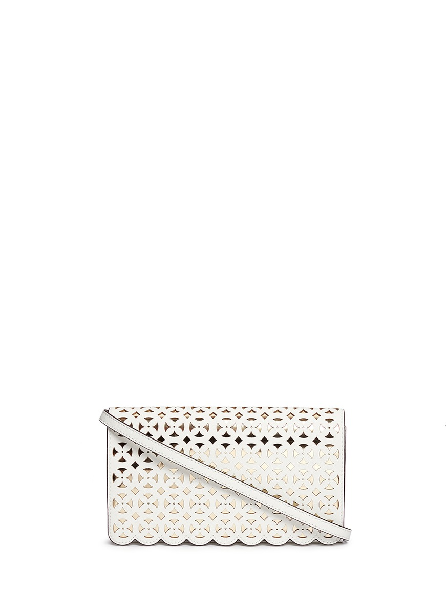 michael kors female desi large floral perforated leather crossbody bag