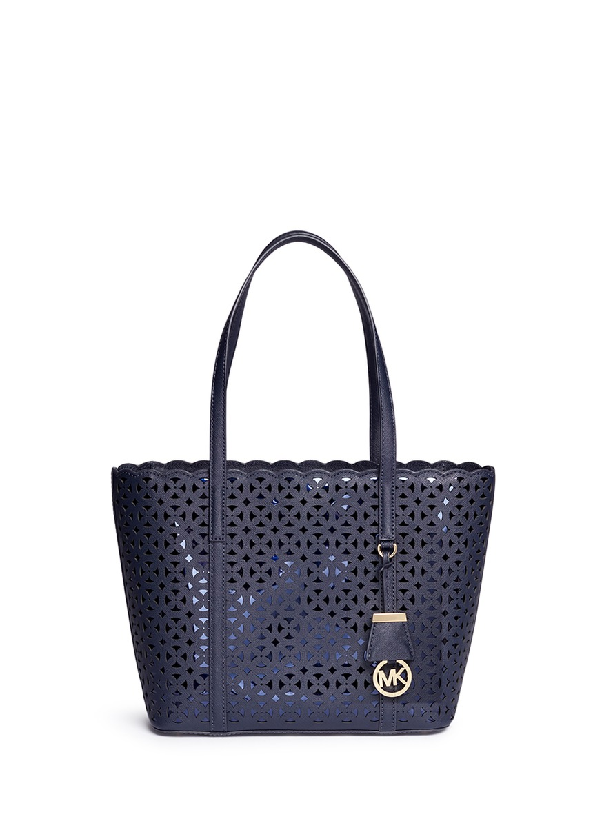 Desi small floral perforated leather travel tote by Michael Kors
