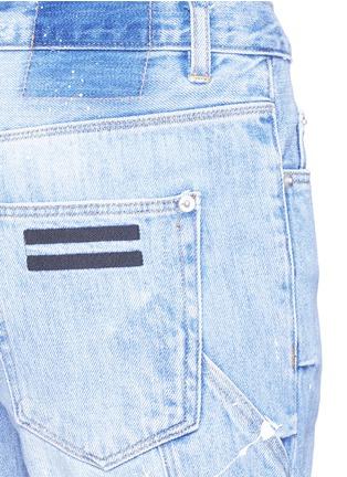 - COCURATA - Paint splatter rolled denim shorts