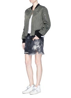 Tortoise 'Manni' distressed mini denim skirt