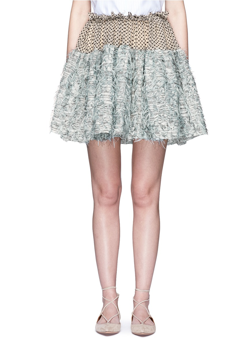 Frayed gauze dot embroidered tulle skirt by Jourden