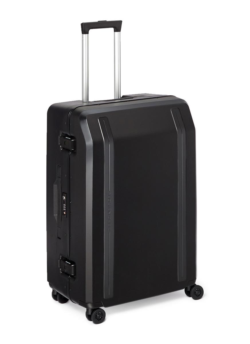 Travellers 26″ four-wheel spinner suitcase by ZERO Halliburton