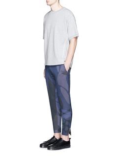 Alexander McQueenSkull camouflage print jogging pants
