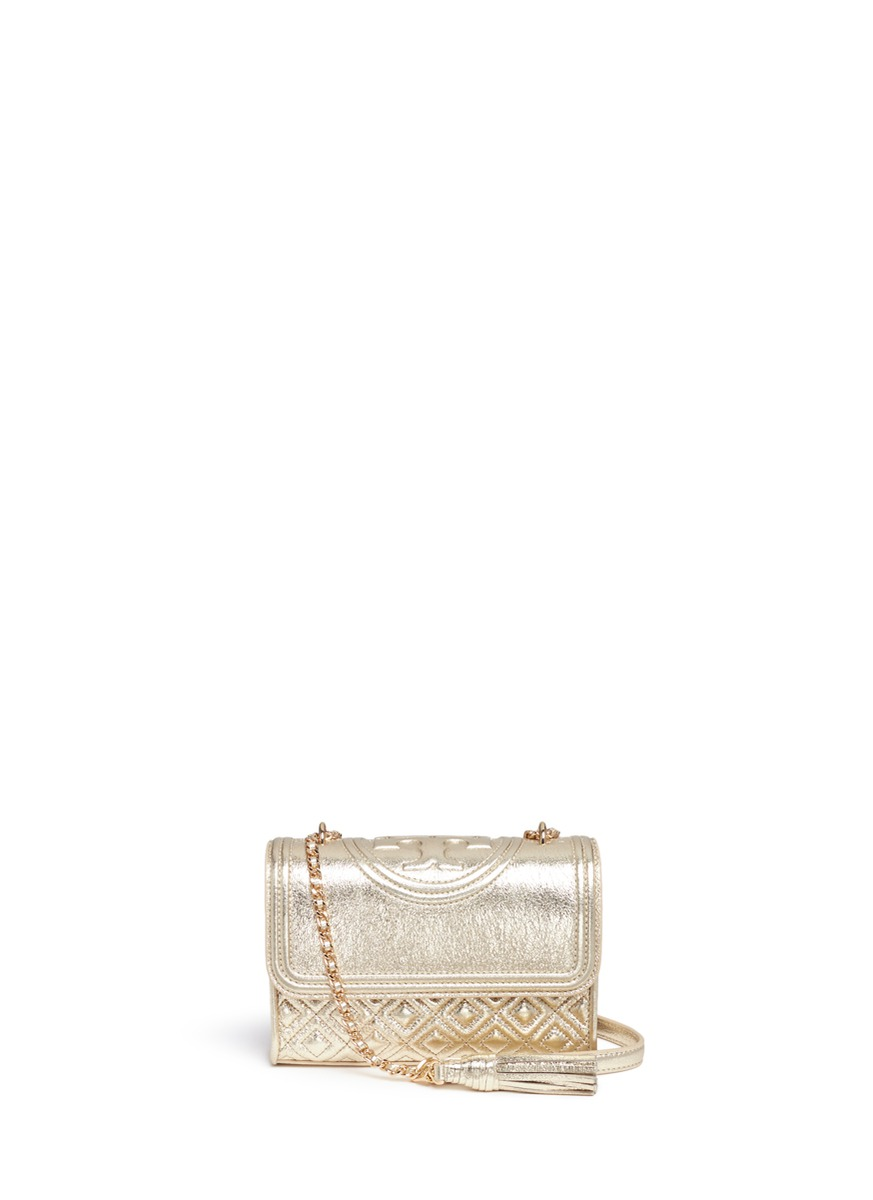 Fleming small convertible metallic leather shoulder bag by Tory Burch