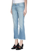 'The Cropped Flip Flop' frayed flare jeans