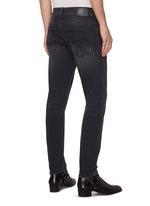 'Boy' paint splatter distressed jeans