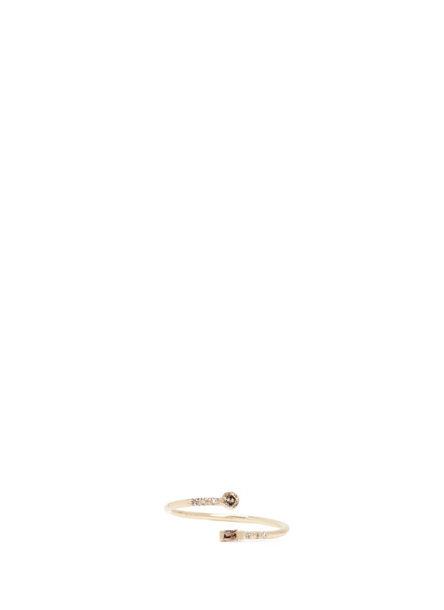 Gravity diamond 14k yellow gold spiral ring by Xiao Wang