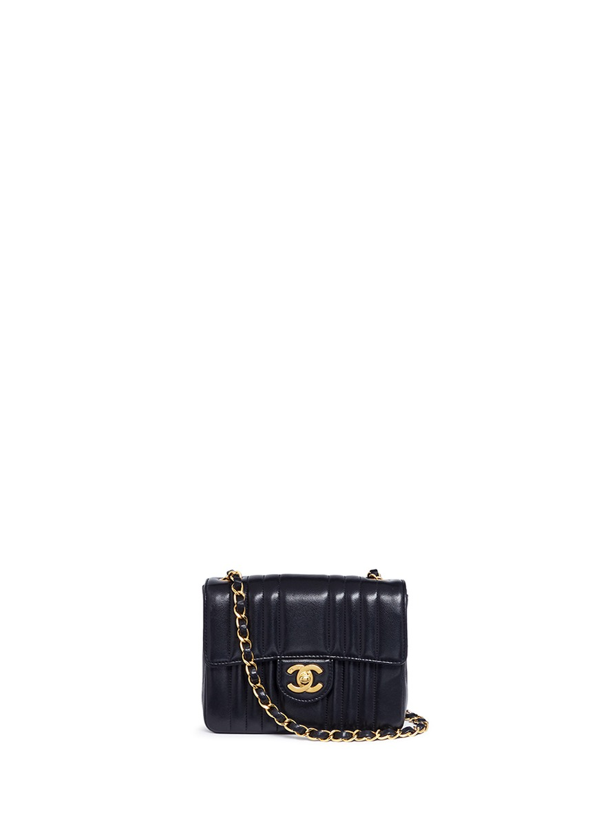 Mini quilted leather flap bag by Vintage Chanel