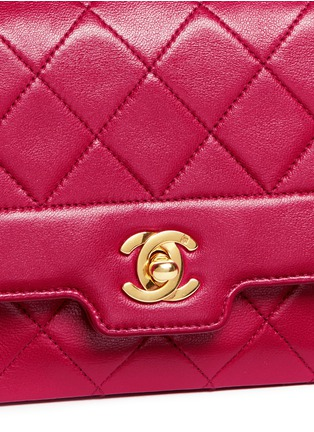 - Vintage Chanel - Border tab mini quilted leather flap bag