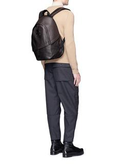 Maison MargielaAsymmetric zip pocket calfskin leather backpack