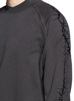 Thorn embroidery sleeve sweatshirt