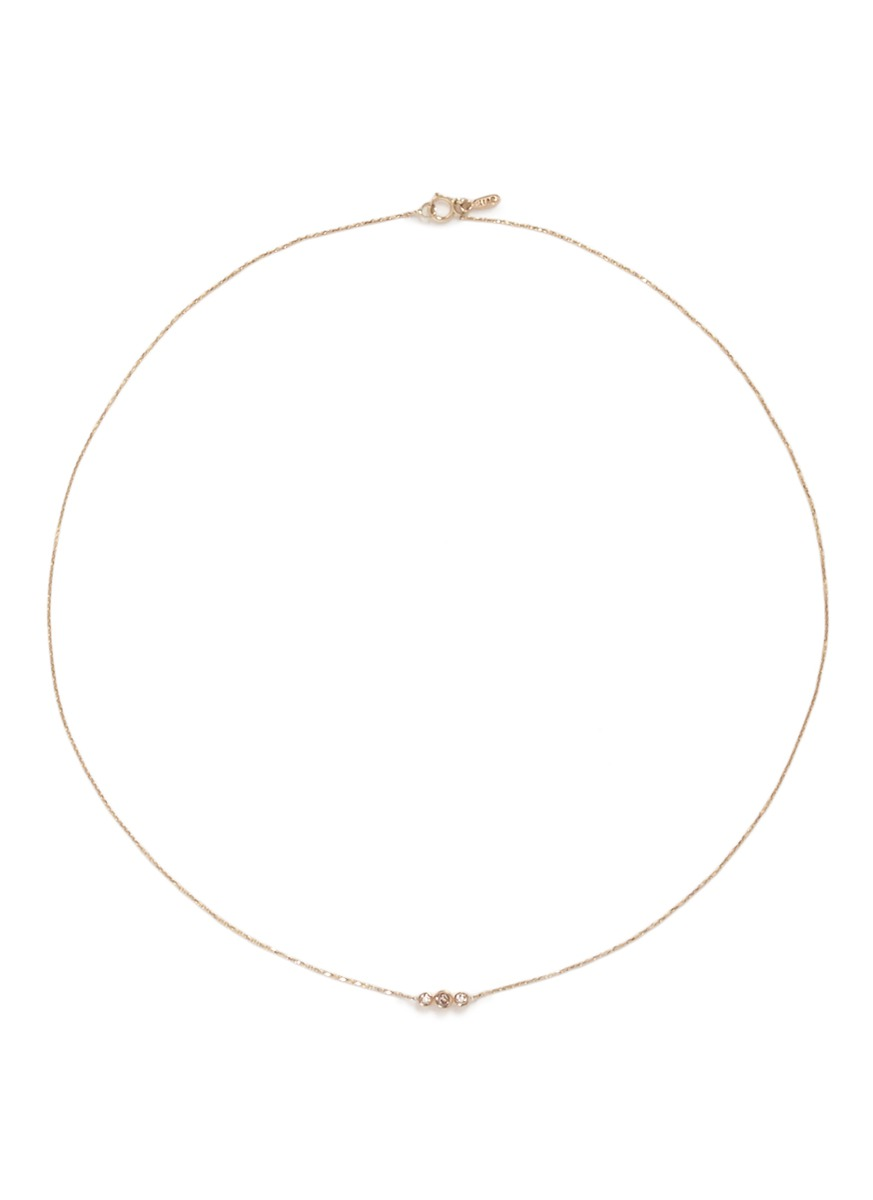 Gravity diamond 14k yellow gold necklace by Xiao Wang