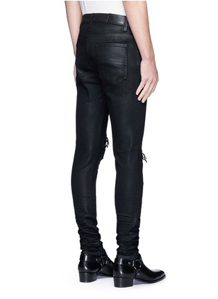 Amiri - 'Thrasher' waxed ripped slim fit jeans