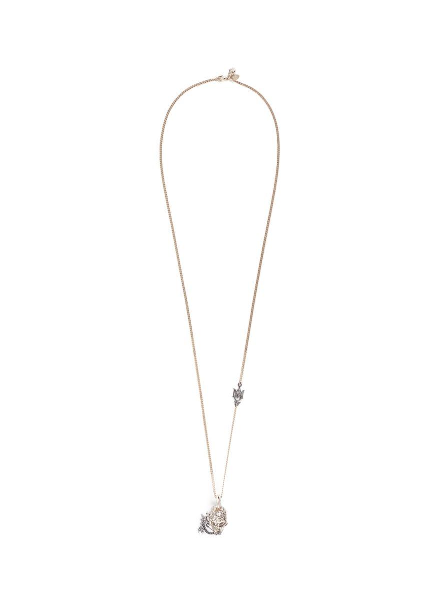 Swarovski crystal pavé piercing skull pendant necklace by Alexander McQueen