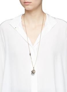Alexander McQueenSwarovski crystal pavé piercing skull pendant necklace