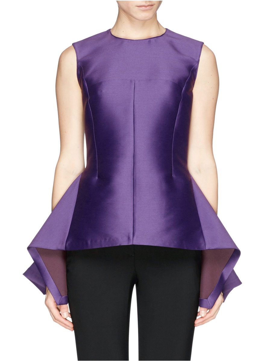 Peplum Top. Ready to infuse your style with a chic, feminine flair? Consider a peplum top. Whether you're headed to the office or a night out on the town, these stylish standouts are sure to enliven any look. Office-Chic Dressing for work? Keep it classic with a simple yet sophisticated silhouette from Lauren Ralph Lauren, Calvin Klein, and others.