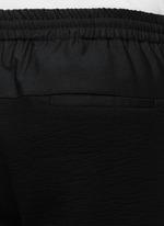Zip cuff crinkled jogging pants
