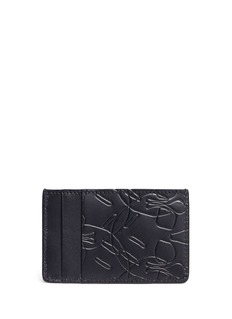 Alexander McQueen Debossed skull leather card holder