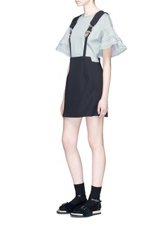 TOGA ARCHIVESEngraved buckle suspender skirt