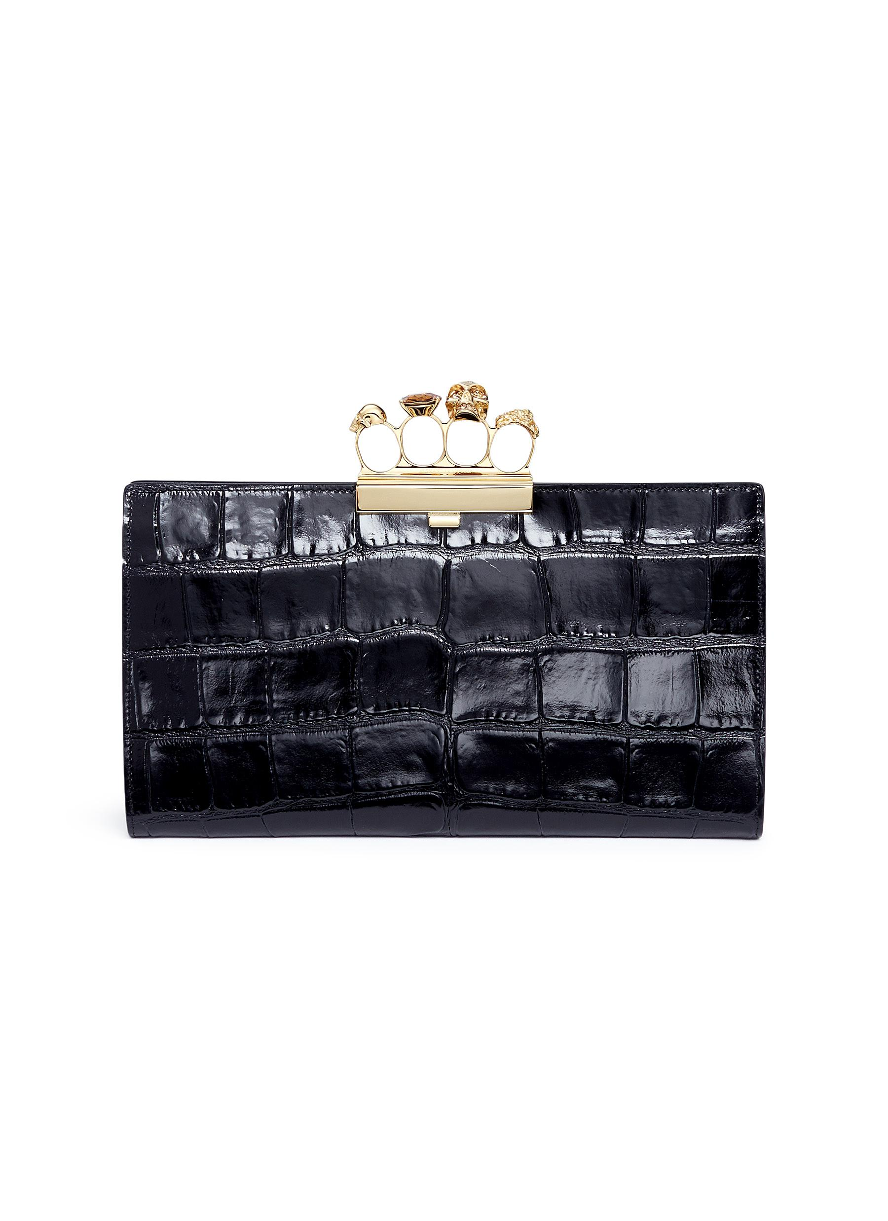 Croc embossed leather knuckle clutch by Alexander McQueen