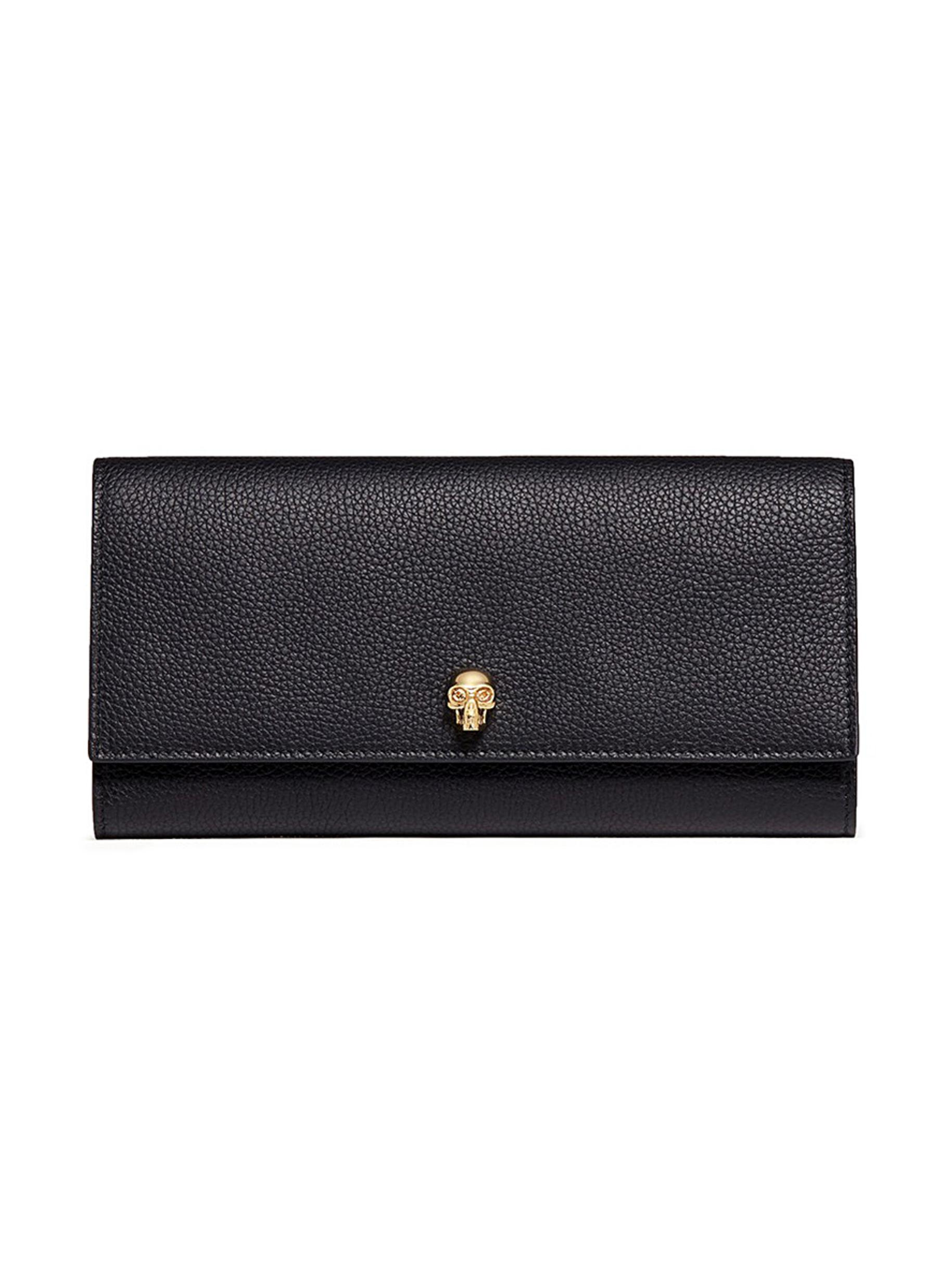 Skull leather travel wallet by Alexander McQueen