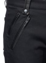 Leather pocket denim pants