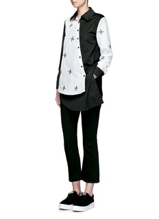 Cynthia & Xiao Embroidered windmill colourblock asymmetric front shirt