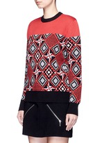 Geometric windmill intarsia sweater