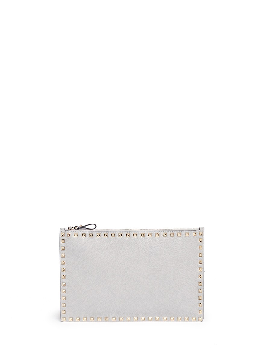 Rockstud large leather flat zip pouch by Valentino