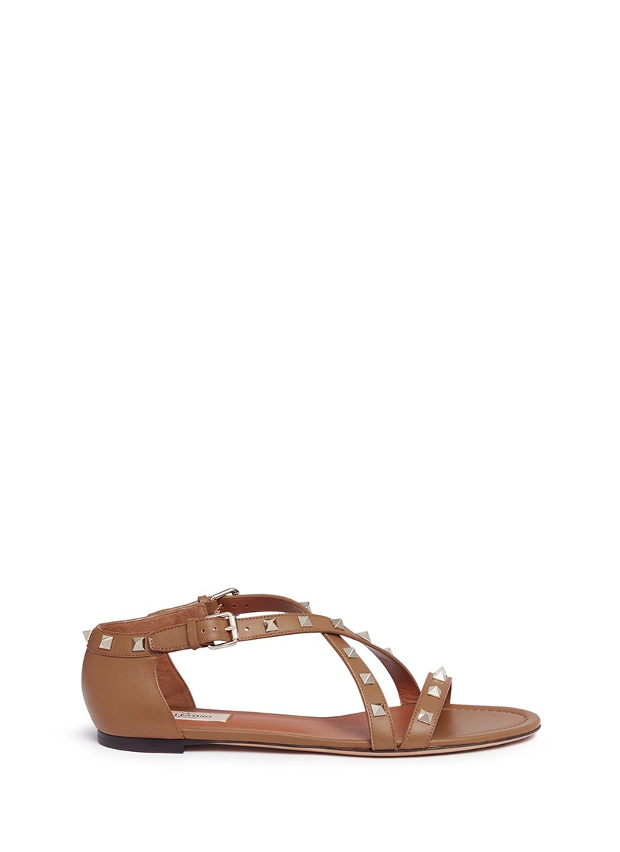 Rockstud cross strap leather sandals by Valentino
