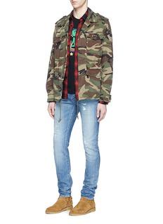 Saint LaurentLow rise rip and repair skinny jeans