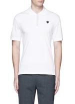 Logo stud placket polo shirt