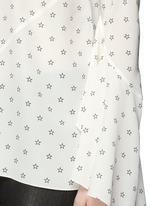 Bell cuff star print silk top